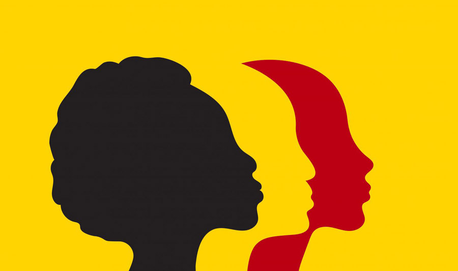 Three silhouettes of women's profiles against a yellow background